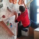 Komplett freies einarmiges Blockieren im Boulderraum