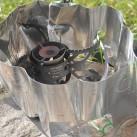 Kocher Polaris Optimus: Windschutz mit Aussparung für den Regler (Feinregulierung)